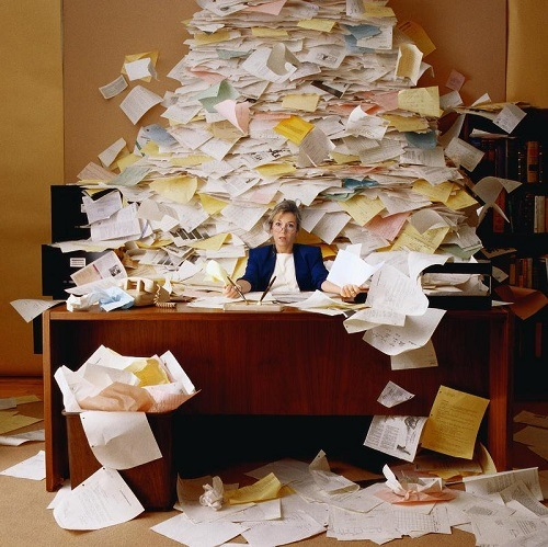 Office cluttered with paper